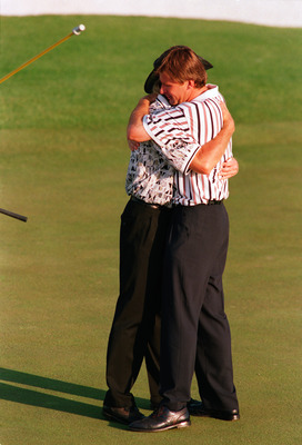 Nick Faldo and Greg Norman embrace on the last hole in the 1996 Masters