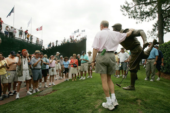 Fans visit the statue of Payne Stewart at Pinehurst