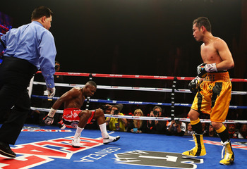 NEW YORK, NY - APRIL 13:  Nonito Donaire knocks down Guillermo Rigondeaux during the tenth round of their WBO/WBA junior featherweight title unification bout at Radio City Music Hall on April 13, 2013 in New York City.  (Photo by Al Bello/Getty Images)