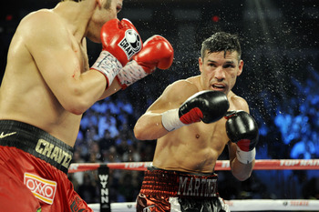 LAS VEGAS, NV - SEPTEMBER 15:  Julio Cesar Chavez Jr. (L) and Sergio Martinez trade punches in the tenth round of their WBC middleweight title fight at the Thomas & Mack Center on September 15, 2012 in Las Vegas, Nevada.  (Photo by Jeff Bottari/Getty Imag