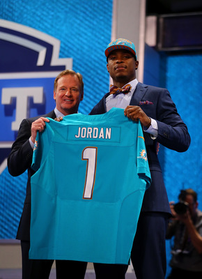 Dion Jordan hoists one of the Fins' new-look jerseys.