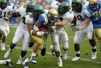 DT Haloti Ngata (96) gets in on a tackle against UCLA