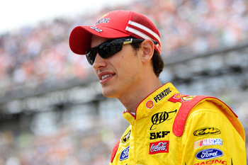 TALLADEGA, AL - MAY 05:  Joey Logano, driver of the #22 Shell Pennzoil Ford, looks on from the grid during the NASCAR Sprint Cup Series Aaron's 499 at Talladega Superspeedway on May 5, 2013 in Talladega, Alabama.  (Photo by Sean Gardner/Getty Images)