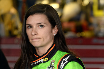 TALLADEGA, AL - MAY 04:  Danica Patrick, driver of the #34 AccuDoc Solutions / GoDaddy Chevrolet, looks on in the garage after she suffered damage to her car and was knocked out of the race during the NASCAR Nationwide Series Aaron's 312 at Talladega Supe