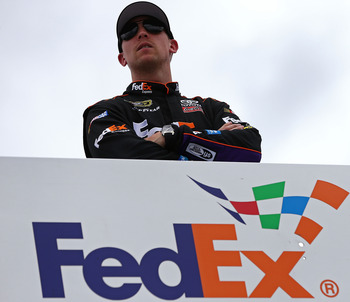 TALLADEGA, AL - MAY 03:  Denny Hamlin, driver of the #11 FedEx Express Toyota, looks on from the top of his hauler during practice for the NASCAR Sprint Cup Series Aaron's 499 at Talladega Superspeedway on May 3, 2013 in Talladega, Alabama.  (Photo by Tom