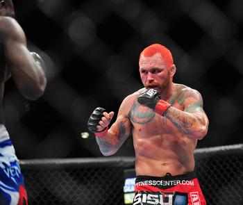 Dec 29, 2012; Las Vegas, NV, USA; Derek Brunson (left) and Chris Leban (right) during UFC 155 at the MGM Grand Garden Arena. Mandatory Credit: Gary A. Vasquez-USA TODAY Sports