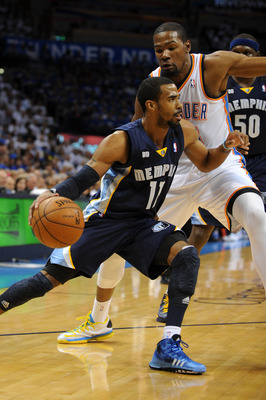 May 7, 2013; Oklahoma City, OK, USA; Memphis Grizzlies guard Mike Conley (11) handles the ball against Oklahoma City Thunder forward Kevin Durant (35) during the first half in game two of the second round of the 2013 NBA Playoffs at Chesapeake Energy Aren