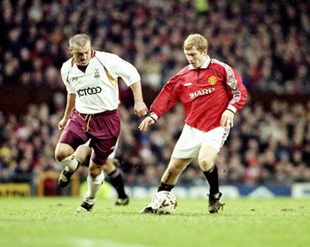 26 Dec 1999:  Paul Scholes of Manchester United is watched by Neil Redfearn of Bradford City during the FA Carling Premiership match at Old Trafford in Manchester, England. United won 4-0. \ Mandatory Credit: Alex Livesey /Allsport