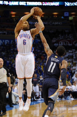 May 7, 2013; Oklahoma City, OK, USA; Oklahoma City Thunder guard Derek Fisher (6) attempts a shot against Memphis Grizzlies guard Mike Conely (11) during the second half in game two of the second round of the 2013 NBA Playoffs at Chesapeake Energy Arena.