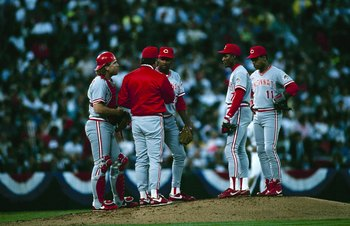 Manager Lou Piniella visits Jose Rijo on the mound in Oakland during Game 4 of the 1990 World Series