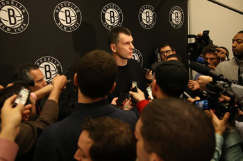 Nets owner Mikhail Prokhorov talks to the media.