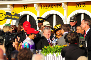 The connections of I'll Have Another celebrate winning the 2012 Preakness Stakes