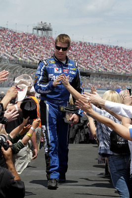 TALLADEGA, AL - MAY 05:  Carl Edwards, driver of the #99 Fastenal Ford, greets fans during driver introdcutins during the NASCAR Sprint Cup Series Aaron's 499 at Talladega Superspeedway on May 5, 2013 in Talladega, Alabama.  (Photo by Jerry Markland/Getty