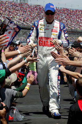 TALLADEGA, AL - MAY 05:  Dale Earnhardt Jr., driver of the #88 National Guard Chevrolet, greets fans during driver introdcutins during the NASCAR Sprint Cup Series Aaron's 499 at Talladega Superspeedway on May 5, 2013 in Talladega, Alabama.  (Photo by Jer