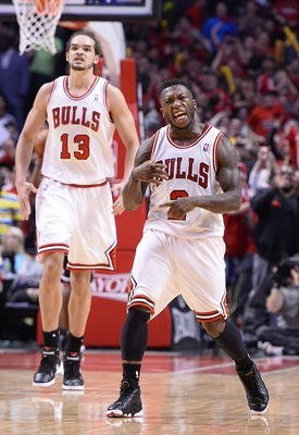 Apr 27, 2013; Chicago, IL, USA; Chicago Bulls point guard Nate Robinson (2) reacts after making a basket against the Brooklyn Nets in the closing seconds of the fourth quarter during game four of the first round of the 2013 NBA playoffs at the United Cent