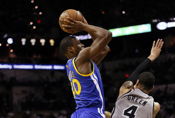 May 8, 2013; San Antonio, TX, USA; Golden State Warriors forward Harrison Barnes (40) gets fouled while shooting against San Antonio Spurs guard Danny Green (4) during the first half in game two of the second round of the 2013 NBA Playoffs at the AT&T Cen
