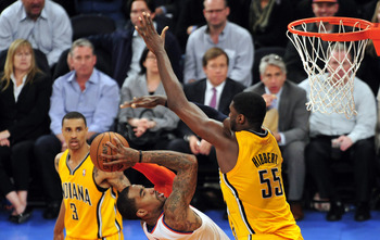 May 7, 2013; New York, NY, USA; New York Knicks shooting guard J.R. Smith (8) attempts a shot over Indiana Pacers center Roy Hibbert (55) during the second half in game two of the second round of the 2013 NBA Playoffs at Madison Square Garden. Knicks won