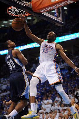 May 7, 2013; Oklahoma City, OK, USA; Oklahoma City Thunder forward Kevin Durant (35) dunks the ball against Memphis Grizzlies forward Darrell Arthur (00) during the first half in game two of the second round of the 2013 NBA Playoffs at Chesapeake Energy A