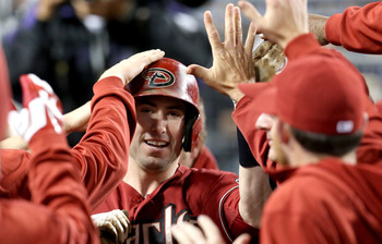 Goldschmidt being congratulated after a home run.