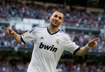 MADRID, SPAIN - APRIL 20:  Karim Benzema of Real Madrid celebrates scoring his sides second goal during the la Liga match between Real Madrid CF and Real Betis Balompie at Estadio Santiago Bernabeu on April 20, 2013 in Madrid, Spain.  (Photo by Jasper Jui