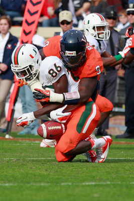 CHARLOTTESVILLE, VA - NOVEMBER 10:  Wide receiver Herb Waters #86 of the Miami Hurricanes attempts to catch the ball as linebacker LaRoy Reynolds #9 of the Virginia Cavaliers defends at Scott Stadium on November 10, 2012 in Charlottesville, Virginia.  (Ph