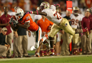 MIAMI GARDENS, FL - OCTOBER 20:  Rashawn Scott #80 of the Miami Hurricanes misses a pass defended by Xavier Rhodes #27 of the Florida State Seminoles during a game  at Sun Life Stadium on October 20, 2012 in Miami Gardens, Florida.  (Photo by Mike Ehrmann