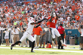 MIAMI GARDENS, FL - SEPTEMBER 29: Phillip Dorsett #4 of the Miami Hurricanes catches the ball for a touchdown past David Amerson #1 of the North Carolina State Wolfpack on September 29, 2012 at Sun Life Stadium in Miami Gardens, Florida. (Photo by Joel Au