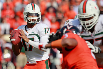 CHARLOTTESVILLE, VA - NOVEMBER 10:  Quarterback Stephen Morris #17 of the Miami Hurricanes prepares to throw the ball as defensive end Ausar Walcott #3 of the Virginia Cavaliers chases at Scott Stadium on November 10, 2012 in Charlottesville, Virginia.  (
