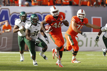 MIAMI GARDENS, FL - NOVEMBER 17: Clive Walford #46 of the Miami Hurricanes runs with the ball against the South Florida Bulls on November 17, 2012 at Sun Life Stadium in Miami Gardens, Florida. The Hurricanes defeated the Bulls 40-9. (Photo by Joel Auerba