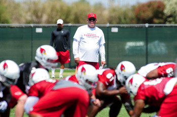 Head coach Bruce Arians looks on as his rookies run a play.