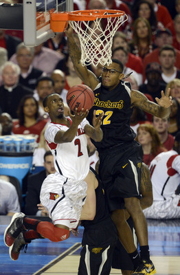 Apr 6, 2013; Atlanta, GA, USA; Louisville Cardinals guard Russ Smith (2) lays the ball up past Wichita State Shockers forward Carl Hall (22) in the second half of the semifinals during the 2013 NCAA mens Final Four at the Georgia Dome.  Mandatory Credit: