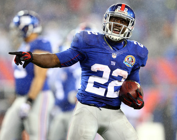 EAST RUTHERFORD, NJ - DECEMBER 09:  David Wilson #22 of the New York Giants celebrates his third touchdown of the game against the New Orleans Saints on December 9, 2012 at MetLife Stadium in East Rutherford, New Jersey.  (Photo by Elsa/Getty Images)