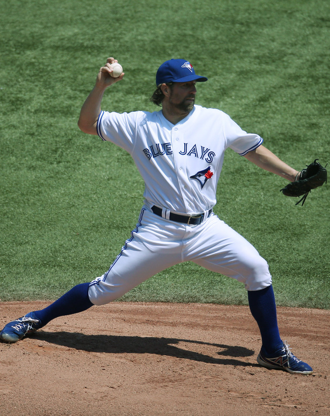 TORONTO, CANADA - MAY 20: R.A. Dickey #43 of the Toronto Blue Jays delivers a pitch during MLB game action against the Tampa Bay Rays on May 20, 2013 at Rogers Centre in Toronto, Ontario, Canada. (Photo by Tom Szczerbowski/Getty Images)
