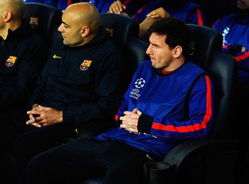 Messi watches from a helpless position on the bench as his team are pulled apart by the steel of Bayern Munich.