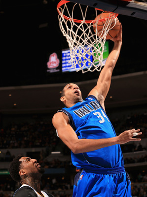 DENVER, CO - APRIL 04:  Brandan Wright #34 of the Dallas Mavericks dunks the ball against Wilson Chandler #21 of the Denver Nuggets at the Pepsi Center on April 4, 2013 in Denver, Colorado. The Nuggets defeated the Mavericks 95-94. NOTE TO USER: User expr