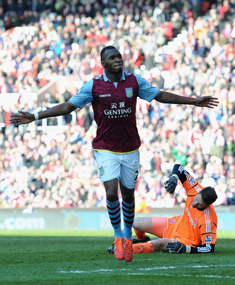 STOKE ON TRENT, ENGLAND - APRIL 06:  Christian Benteke of Aston Villa celebrates scoring his team's third goal to make the score 1-3 during the Barclays Premier League match between Stoke City and Aston Villa at the Britannia Stadium on April 6, 2013 in S