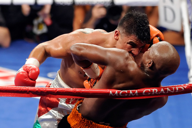 LAS VEGAS, NV - SEPTEMBER 17:  Victor Ortiz reaches his head out as Floyd Mayweather Jr. is against the rope in the fourth round during their WBC welterweight title fight at the MGM Grand Garden Arena on September 17, 2011 in Las Vegas, Nevada. Referee Jo