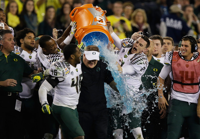 GLENDALE, AZ - JANUARY 03:  Michael Clay #46 and Bryan Bennett #2 dump the gatorade cooler on head coach Chip Kelly of the Oregon Ducks after their 35 to 17 victory over the Kansas State Wildcats in the Tostitos Fiesta Bowl at University of Phoenix Stadiu