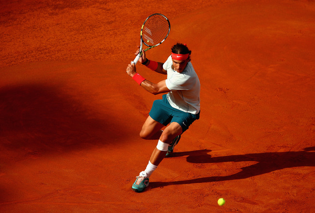 ROME, ITALY - MAY 18:  Rafael Nadal of Spain in action during his semi final match against Tomas Berdych of the Czech Republic on day seven of the Internazionali BNL d'Italia 2013 at the Foro Italico Tennis Centre on May 18, 2013 in Rome, Italy.  (Photo b