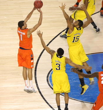 Apr 6, 2013; Atlanta, GA, USA; Syracuse Orange guard Michael Carter-Williams (1) shoots over Michigan Wolverines forward Jon Horford (15) in the first half of the semifinals during the 2013 NCAA mens Final Four at the Georgia Dome.  Mandatory Credit: Dani