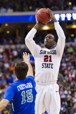 Mar 24, 2013; Philadelphia, PA, USA; San Diego State Aztecs guard Jamaal Franklin (21) shoots a jump shot over the defense of Florida Gulf Coast Eagles forward Filip Cvjeticanin (15) during the second half during the third round of the NCAA basketball tou