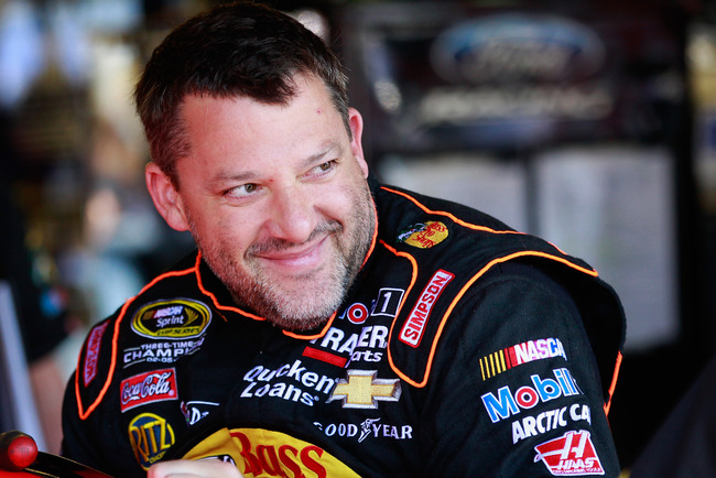 DARLINGTON, SC - MAY 10:  Tony Stewart, driver of the #14 Bass Pro Shops / Mobil 1 Chevrolet, smiles in the garage during practice for the NASCAR Sprint Cup Series Bojangles' Southern 500 at Darlington Raceway on May 10, 2013 in Darlington, South Carolina