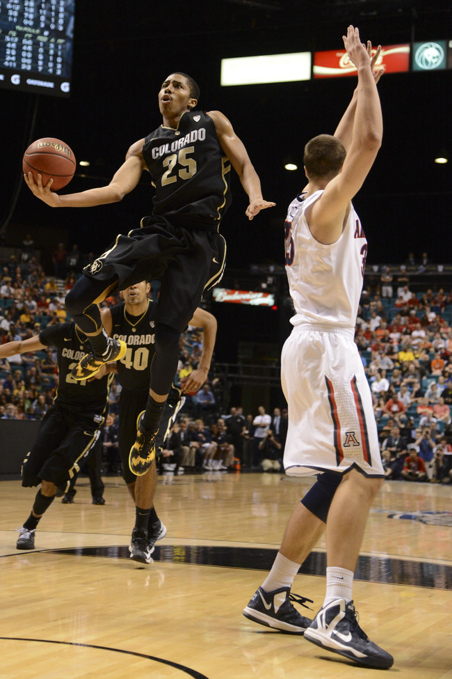 March 14, 2013; Las Vegas, NV, USA; Colorado Buffaloes guard Spencer Dinwiddie (25) shoots against Arizona Wildcats center Kaleb Tarczewski (35) during the second half in the second round of the Pac 12 tournament at the MGM Grand Garden Arena. Arizona def