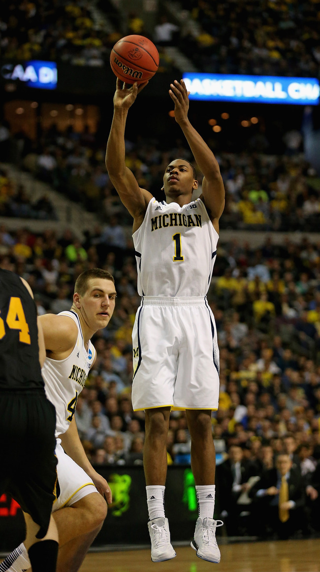 AUBURN HILL, MI - MARCH 26: Glenn Robinson III #1 of the Michigan Wolverines shoots against the South Dakota State Jackrabbits during the second round of the 2013 NCAA Men's Basketball Tournament at The Palace of Auburn Hills on March 21, 2013 in Auburn H