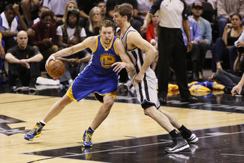 May 14, 2013; San Antonio, TX, USA; Golden State Warriors forward David Lee (10) is defended by San Antonio Spurs forward Tiago Splitter (right) during the second half in game five of the second round of the 2013 NBA Playoffs at the AT&T Center. Mandatory