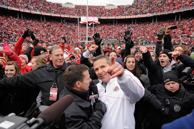 COLUMBUS, OH - NOVEMBER 24:  Head coach Urban Meyer of the Ohio State Buckeyes celebrates the Buckeyes' 26-21 win over the Michigan Wolverines at Ohio Stadium on November 24, 2012 in Columbus, Ohio.  (Photo by Jamie Sabau/Getty Images)