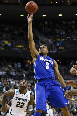 Mar 23, 2013; Auburn Hills, MI, USA; Memphis Tigers guard Chris Crawford (3) shoots the ball in the second half against the Michigan State Spartans during the third round of the NCAA basketball tournament at The Palace. Michigan State won 70-48. Mandatory