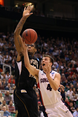 SALT LAKE CITY, UT - MARCH 23:  Kevin Pangos #4 of the Gonzaga Bulldogs goes up for a shot between Carl Hall #22 and Demetric Williams #5 of the Wichita State Shockers in the first half during the third round of the 2013 NCAA Men's Basketball Tournament a