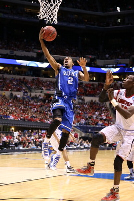 INDIANAPOLIS, IN - MARCH 31:  Quinn Cook #2 of the Duke Blue Devils drives for a shot attempt against the Louisville Cardinals during the Midwest Regional Final round of the 2013 NCAA Men's Basketball Tournament at Lucas Oil Stadium on March 31, 2013 in I