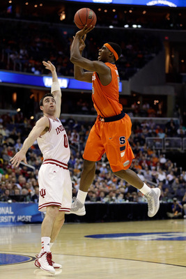 WASHINGTON, DC - MARCH 28:  C.J. Fair #5 of the Syracuse Orange shoots the ball against Will Sheehey #0 of the Indiana Hoosiers during the East Regional Round of the 2013 NCAA Men's Basketball Tournament at Verizon Center on March 28, 2013 in Washington,
